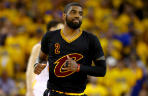 OAKLAND, CA - JUNE 19:  Kyrie Irving #2 of the Cleveland Cavaliers reacts after scoring in Game 7 of the 2016 NBA Finals against the Golden State Warriors at ORACLE Arena on June 19, 2016 in Oakland, California. NOTE TO USER: User expressly acknowledges and agrees that, by downloading and or using this photograph, User is consenting to the terms and conditions of the Getty Images License Agreement.  (Photo by Ezra Shaw/Getty Images)